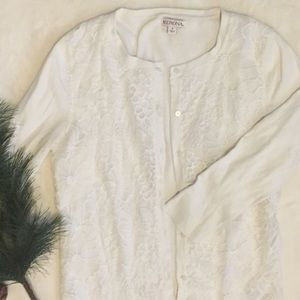 White cardigan with lace on the front.